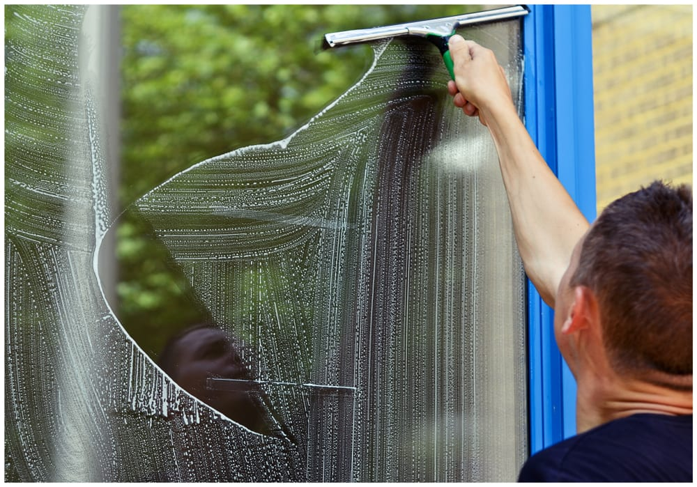 Man cleaning window using Window Cleaning Squeegee